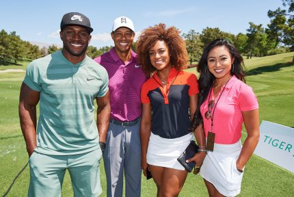 Tiger Woods poses with Reggie Bush, Troy Mullins and Tisha Alyn